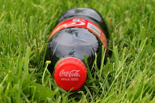 50% recycled plastic use milestone reached by Coca-Cola